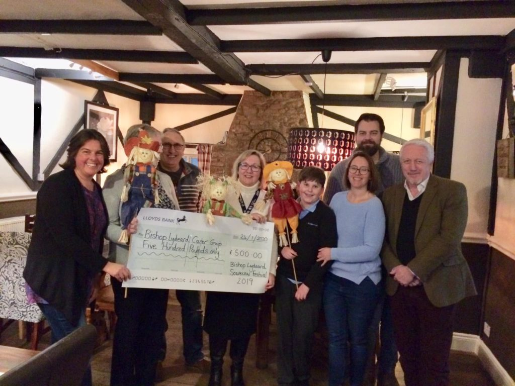 bishops lydeard scarecrow festival cheque presentation to village carers group